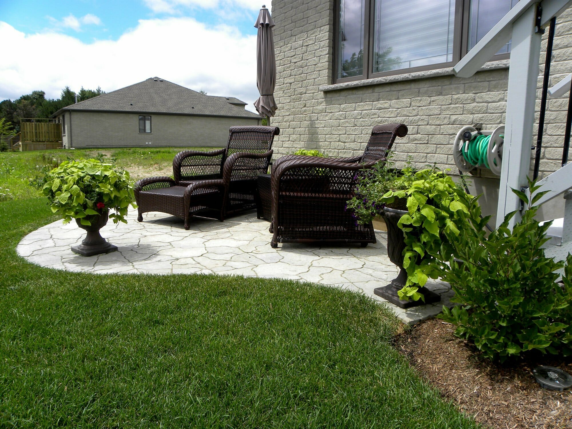 Small Interlock Patio with Planters - London, Ontario Landscaping & Custom Landscape Design