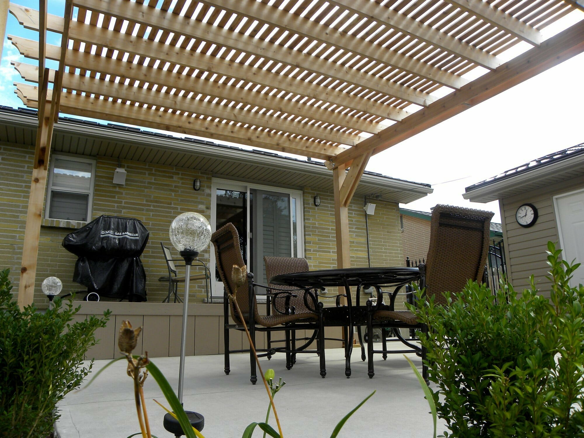 Backyard Woodworking Pergola - London, Ontario Landscaping & Custom Landscape Design